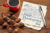 Happy Thanksgiving word cloud - handwriting on a napkin with a cup of coffee and fall decoration poster