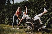 Patient Undergoes Rehabilitation. Cancer Patient Stands Up . Woman With Daughter. Woman Glad See Dau poster
