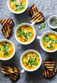 Turmeric Pumpkin Vegetarian Soup On Grey Background, Top View. Flat Lay Butternut Squash Soup Served poster