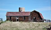 A Weathered Barn Stands Near The Back Of This Abandoned Farm On The Colorado Plains. poster