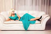 Beautiful blond in blue formal dress poster