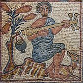 stock photo of minstrel  - Libya Cyrenaica Qzar Ancient well preserved Byzantine mosaic depicting a musician and fruit tree - JPG