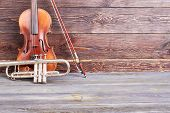 Aged Violin And Trumpet On Wooden Background. Old Musical Instruments And Copy Space. Instrumental M poster