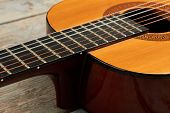 Close Up Acoustic Guitar Instrument. Detail Of Wooden Guitar. Classical Musical Instrument. poster