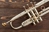 Close Up Trumpet On Brown Wooden Background. Valve Of Trumpet Instrument. Orchestra Music Instrument poster