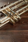 Detail Of Old Trumpet Instrument. Close Up Trumpet On Wooden Background With Copy Space. Classical O poster