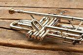 Herald Trumpet On Old Wooden Background. Valve Of Vintage Trumpet Instrument. Orchestra Music Instru poster