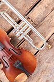 Old Musical Instruments Of Symphony Orchestra. Trumpet And Violin On Grunge Wood. Professional Music poster