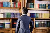 Library Books Concept. Man In Formal Wear Looks At Library Books poster