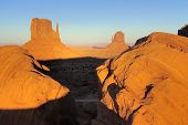 Boulders Framing Mittens In Monument Valley, Navajo Nation poster