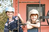 foto of caboose  - Two Little Engineers On The End of a Caboose - JPG