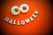 Cheerful Emotional Inscription Made Of Wooden Letters. The Word Halloween In The Form Of A Smile And poster