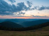 Background Of Carpathians Mountains, West Ukraine. The Sun On Horizon, Dense Clouds In Evening Sky,  poster