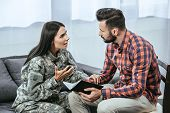 Female Soldier With Post Traumatic Syndrome Asking For Help Of Psychiatrist During Therapy poster