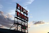 public market sign at sunset with blue skies and fluffy colorful clouds in the background poster