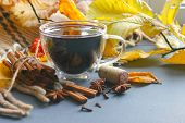 A Cup Of Mulled Wine Surrounded By Yellow Autumn Leaves And Spices, Cinnamon Sticks, Anise, Cloves.  poster