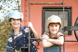 stock photo of caboose  - Two Little Engineers On The End of a Caboose - JPG