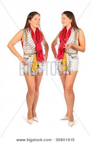 Two same women talk in studio on white background. First woman looks at camera and second woman makes gesture.
