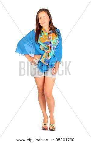 Beautiful woman dressed in shorts and blue pareo poses in studio on white background.