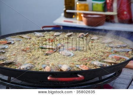 OLHAO, PORTUGAL - AUG 8:  Workers cooking seafood at seafood event on August 8, 2012 in Olhao, Portugal.