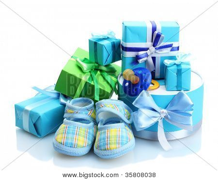 beautiful gifts, baby's bootees and dummy isolated on white