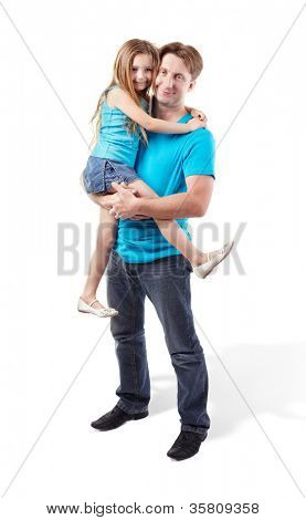 Father in blue shirt holds daughter on his hands