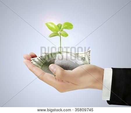 Saving money concept in hand businessmen