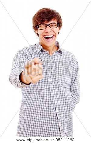Smiling latin young man showing forefinger on something and laughing very much. Isolated on white background, mask included