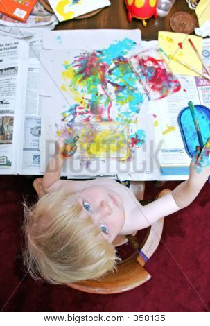 Photo From Above Of Young Boy Painting