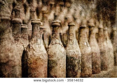 A lot of old wine bottles covered with dust in grunge and retro style