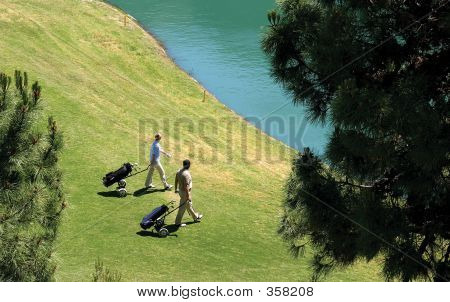Two Golfers Walking Towards Their Golf Balls In The Lake