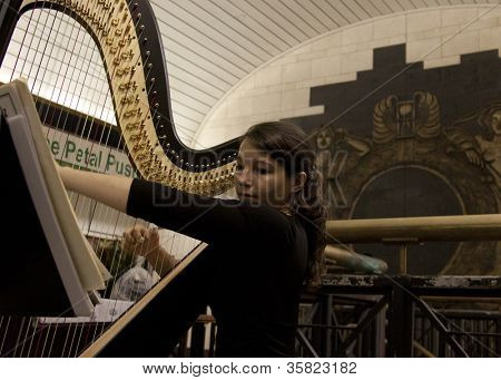 NEW YORK-JUL 28: Harpist Emily Hopkins performs in Penn Station on July 28, 2012 in New York, NY. She is on MTA'Ã??Ã??s official roster for the transit talent program called Music Under New York.
