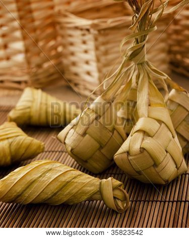 Asian cuisine ketupat or packed rice in low light setting.