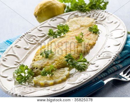 breaded sole fish with parsley and lemon