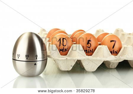 eggs in box and egg timer isolated on white