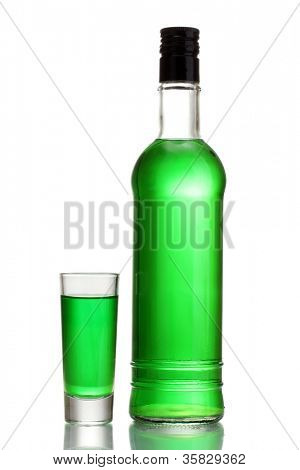 bottle and glass of absinthe isolated on white