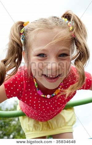 Playful Girl Plays On The Playground