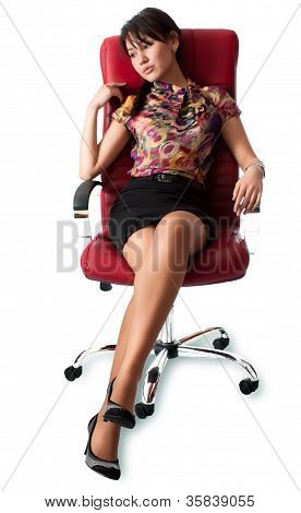Contemplative Young Woman Sitting On Chair
