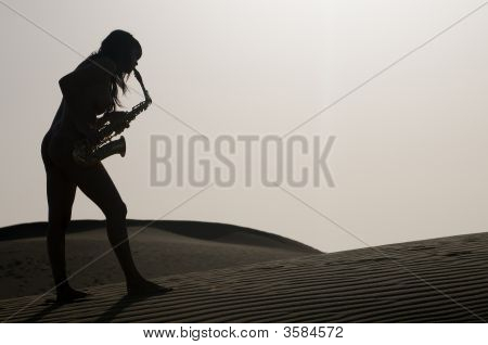 Silhouette Of A Woman Playing Saxophone