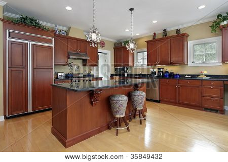 Kitchen in luxury home with cherrywood cabinetry