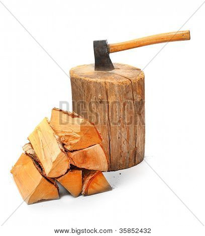 Cut logs fire wood and old axe. Renewable resource of a energy. Environmental concept.