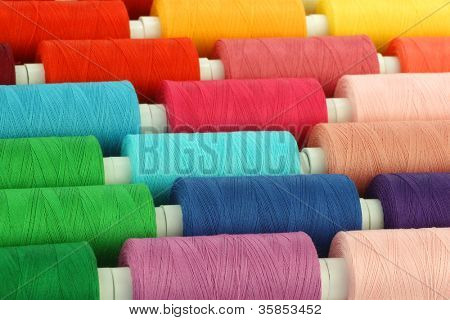 colorful spindles of yarn background