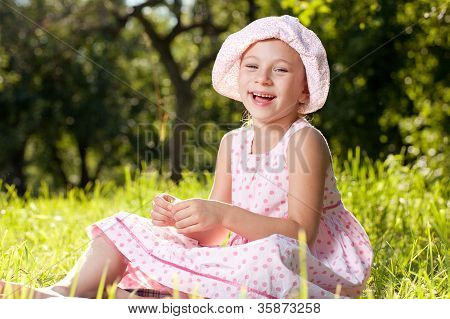 Cheerful Girl Laughing In The Summer Dress