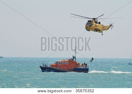 EASTBOURNE, ENGLAND - AUGUST 11: A Westland Sea King HAR3 helicopter of the RAF Search and Rescue squadron, demonstrates at the Airbourne airshow on August 11, 2012 at Eastbourne, East Sussex.