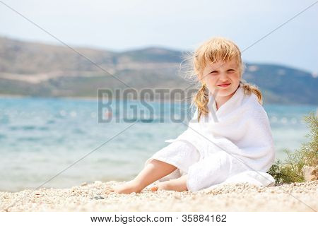 Kid relaxing on the beach