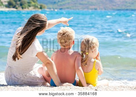 Mother with her children by the sea