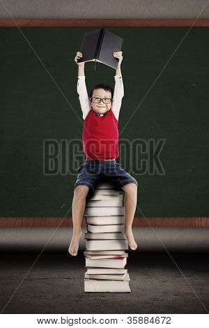 Smart Student Sitting On The Books