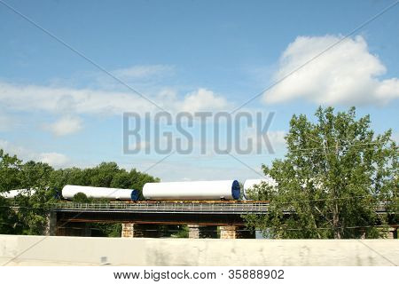 White cones and tubes on railroad