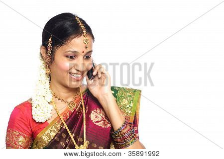 Traditional Woman Talking On Cellphone