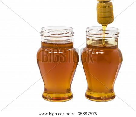 Two jars of honey isolated on white backgrond